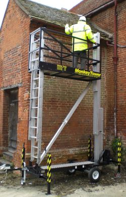 Monkey Tower at 6.5m working height, allowing two users to be up and fixing guttering in 5 minutes